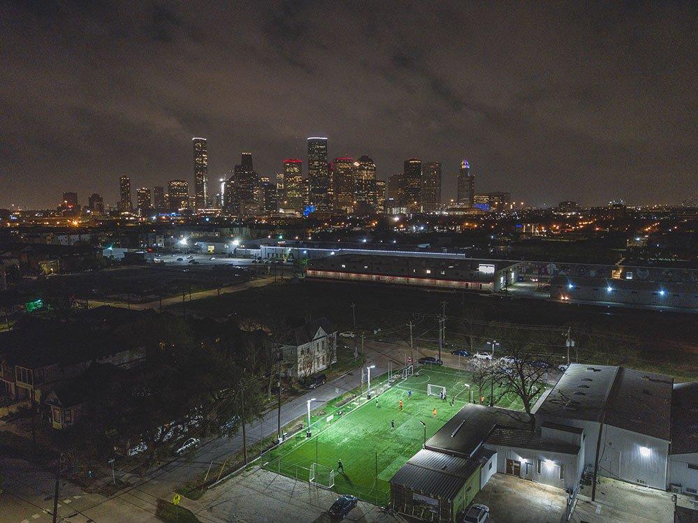 Skyline background soccer field drone photo