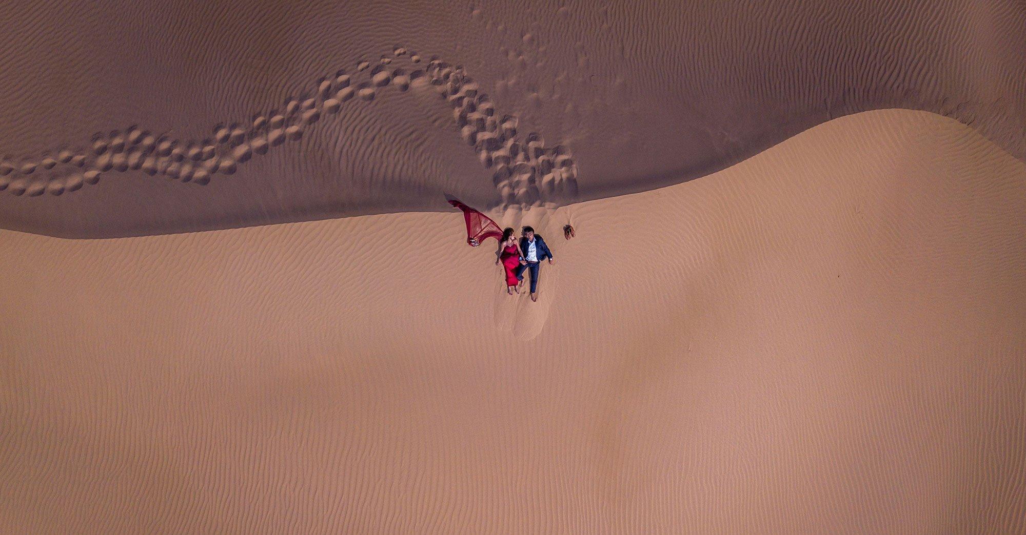 Couple engagement announcement drone photo shoot