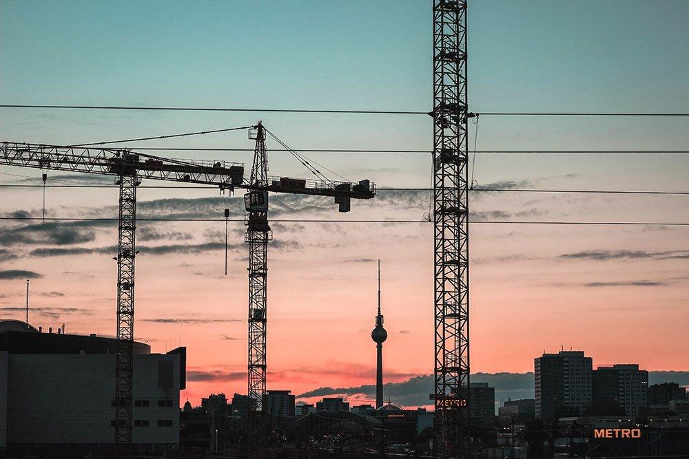 Construction cranes in Berlin at sunrise
